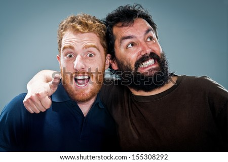 Young Happy Men Shouting Over a Grey Background - stock photo