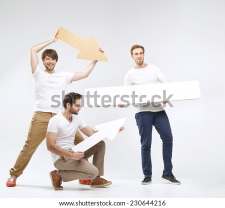 Young happy men with empty board  - stock photo