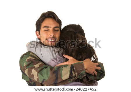 young happy military soldier returns to meet his wife girlfriend hug isolated on white - stock photo