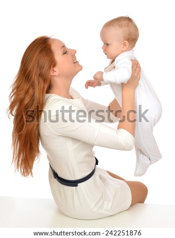 Young happy mother woman holding in her arms infant child baby kid girl on a white background - stock photo