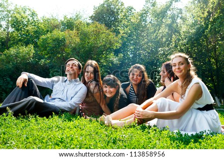 Young happy people having fun in the park - stock photo