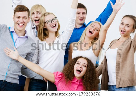 Young happy people in classroom screaming joyfully