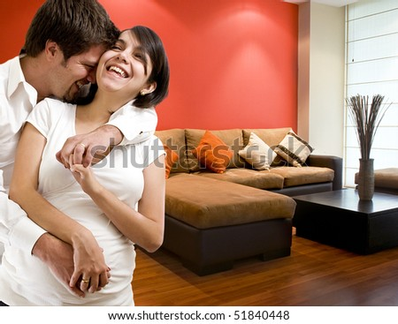 young happy pregnant couple at new department - stock photo