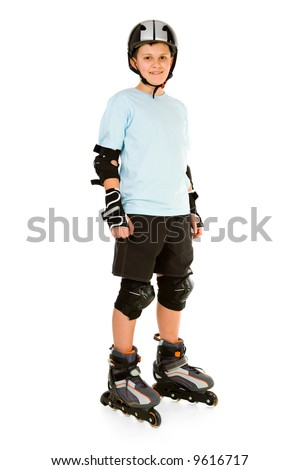 Young, happy roller boy in protection kit standing and looking at camera. Front view. Isolated on white background. - stock photo