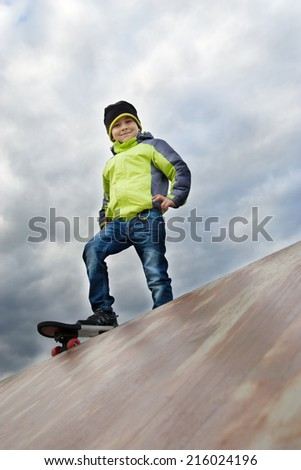 Young happy skater training on the table