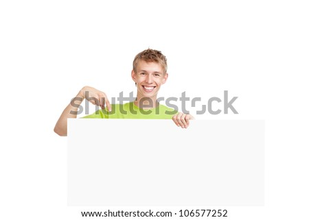 young happy smile man standing hold pointing finger at a blank board, handsome guy wear green shirt, isolated over white background, studio shoot