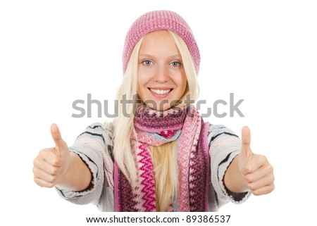 young happy smile teenage girl holding two hands with thumb up gesture,  wear winter knitted pink hat scarf and sweater, isolated over white background - stock photo