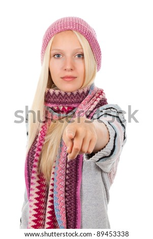 young happy smile teenage girl point finger at you gesture, looking at camera, wear winter knitted pink hat scarf and sweater, isolated over white background - stock photo