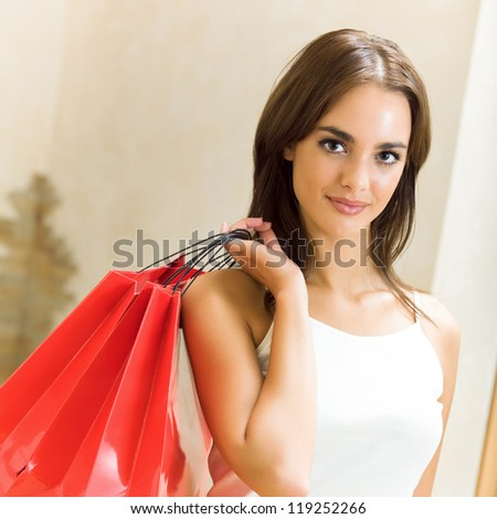 Young happy smiling attractive woman with shopping bags