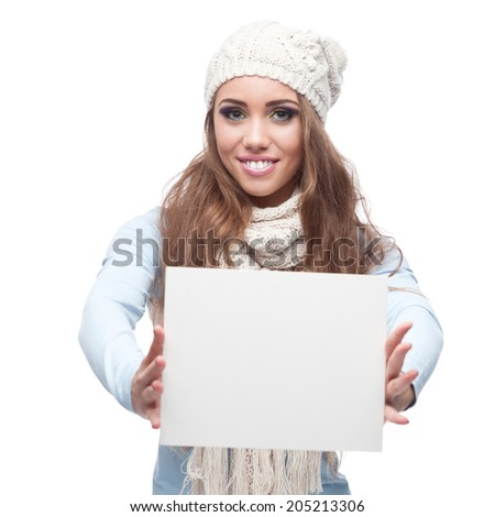 young happy smiling caucasian brunette woman in winter clothing holding sign isolated on white - stock photo
