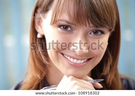 Young happy smiling cheerful business woman at office - stock photo