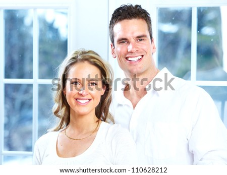 Young Happy smiling couple in a new home.