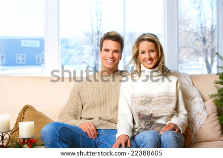 Young  happy smiling couple in love. Christmas