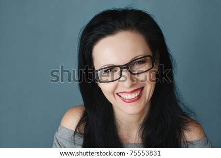 Young happy smiling woman in glasses