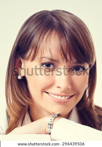 Young happy smiling woman in white business style clothing with textbooks - stock photo