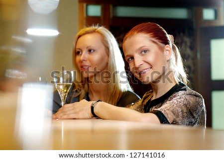 Young happy smiling woman with glass of wine at restaurant - stock photo