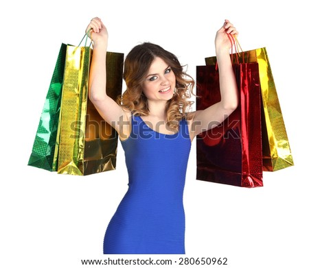 Young happy smiling woman with shopping bags, isolated on white background - stock photo