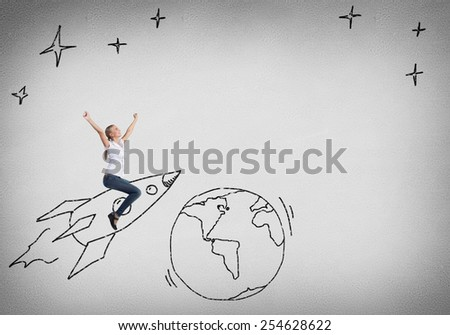 Young happy student girl riding drawing rocket - stock photo