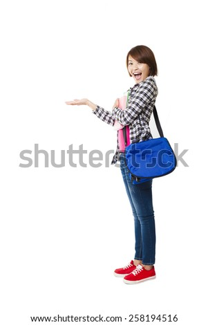 Young happy student with books and showing something - stock photo