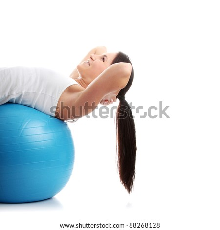 Young happy woman doing fitness exercise, isolated on white