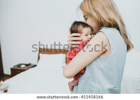 young happy  woman  embracing her wonderful little girl