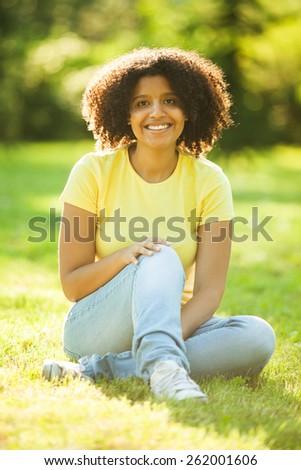 Young happy woman enjoying summertime - stock photo