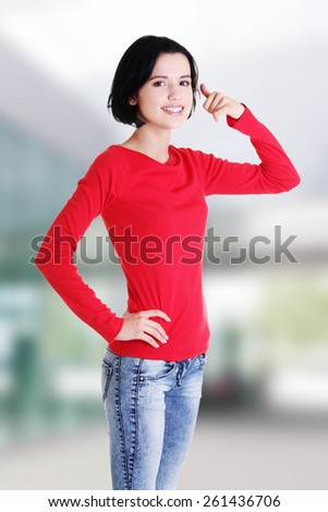 """Young happy woman gesturing """"call me"""". - stock photo"""