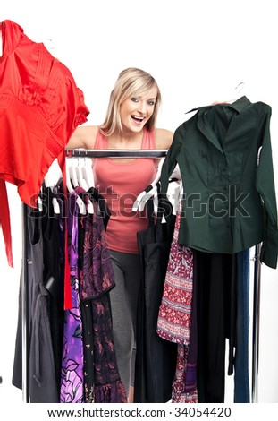 Young happy woman has a plenty of clothes to choose from
