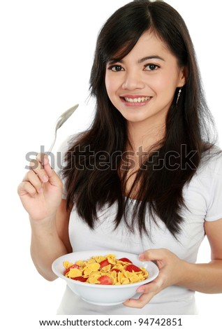 young happy woman holding a bowl of cereal isolated over white background - stock photo