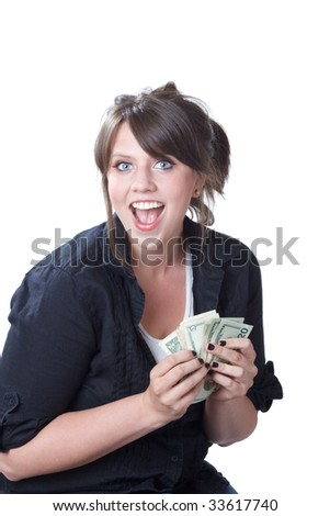Young, happy woman holding money in her hands; isolated on a white background. - stock photo