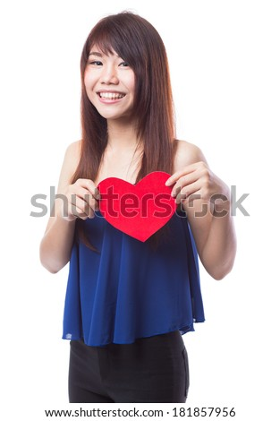 Young happy woman holding red heart on white background, Love symbol.