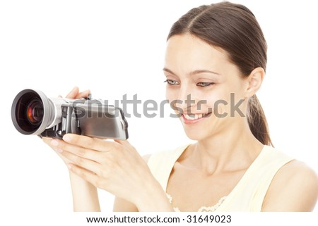 Young happy woman holding small video camera. Isolated over white background. - stock photo