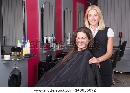 young happy woman in beauty salon getting a hair cut - stock photo