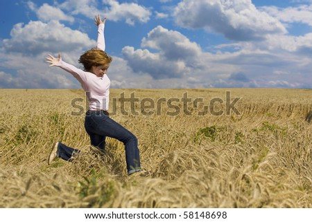 Young happy woman in field - stock photo