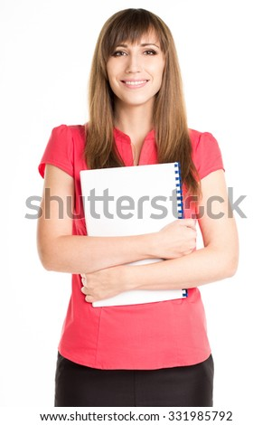 Young happy woman in red shirt holding exercise book or course book. Pretty businesswoman with notebook isolated on white background