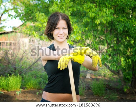 young happy woman in the garden
