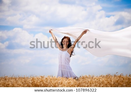 Young happy woman in wheat field