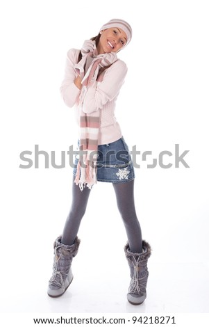 young happy woman in winter clothes on a white bg - stock photo
