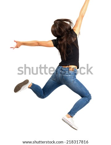 Young happy woman jumping out of frame. Isolated over white background.