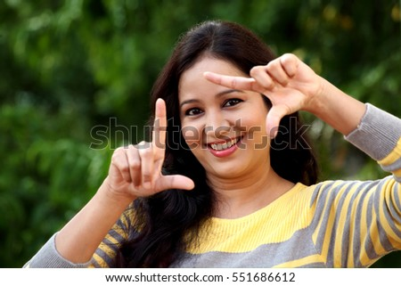 Young happy woman making framing gesture