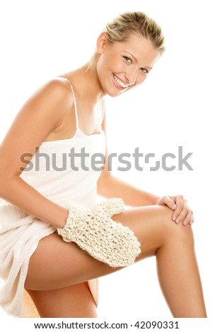 Young happy woman massaging her thigh with sisal glove isolated on white background - stock photo