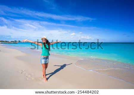Young happy woman on beach during her summer vacation