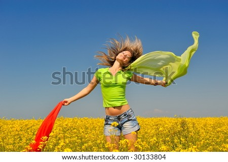 young happy woman on blooming rapeseed field
