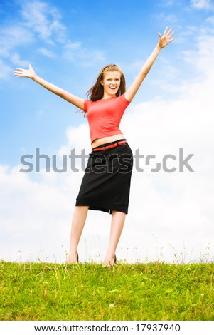 Young happy woman on sky background. - stock photo