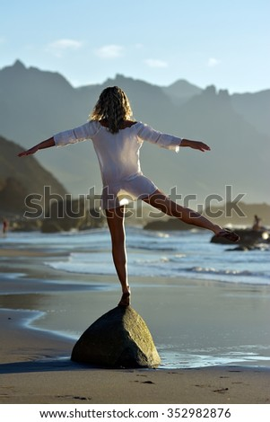 young happy woman on the beach in summer vacation - stock photo