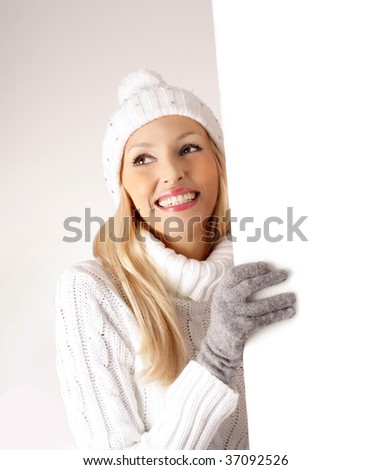 Young happy woman over white board - stock photo