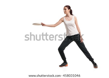 young happy woman playing with flying disc