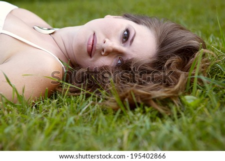 young happy woman relaxing and enjoying life in nature
