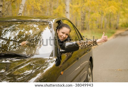 young happy woman sitting in her car