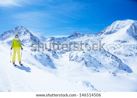young happy woman ski with beautiful mountain landscape for copy space - stock photo